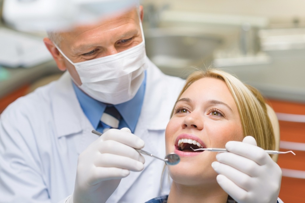 Healthy teeth patient at dentist office dental caries prevention